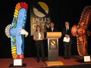 Tiana accepts the Peoples Choice Award at the Great Eagle Auction