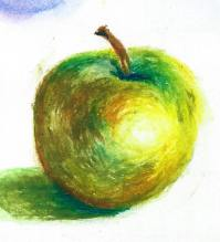 This green apple is in oil pastel, which is a little tricky to blend. Start with light strokes in a variety of colours and build up the layers.